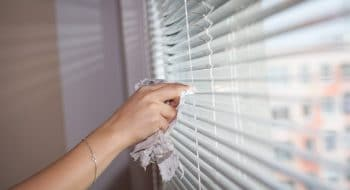Instead of cleaning blinds, installing curtains is one of the low-maintenance home remodeling ideas.